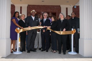 Local Leaders help cut the Ribbon for Caribe Funeral Home