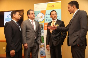 Trinidad & Tobago's Trade, Industry & Investment Minister, Vasant Bharath, second from right, chats with (l to r): President of InvesTT , Kelvin Mahabir,; TIC Chairman,  Anthony Aboud, and Managing Director Full Circle Animation, Jason Lindsay, during the formal launch of the Caribbean Investment Forum held at the Hyatt Hotel on May 14, 2013. (PHOTO: SHIRLEY BAHADUR)