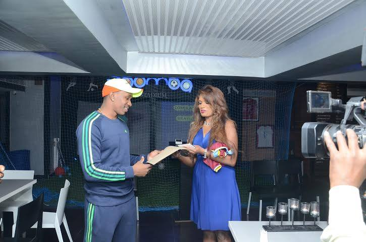 Dwayne Bravo receiving his history-making contracts from his Agent on the eve of his signing to China Harbour.