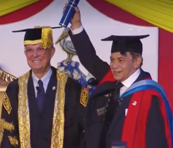 Monty Alexander, CD, receiving the Hon. Doctorate of Letters degree from UWI Mona Campus Chancellor Robert Bermudez at the 2018 graduation ceremonies on Nov. 3, 2018.